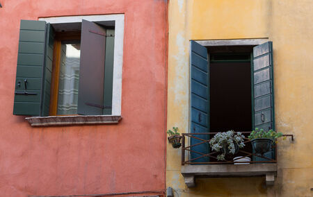Two windows on colorful Venice, Italy buildings taken in daylight