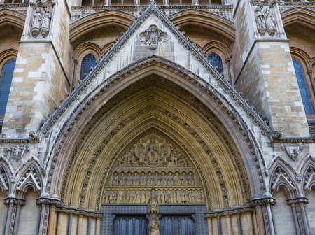 View of the trumeau and archivolts on the side entrance to Westminster Abbey in London, England