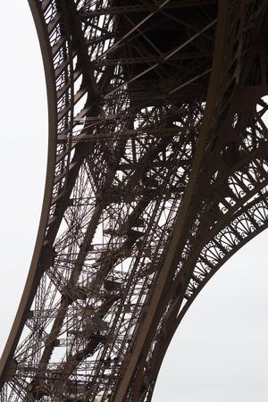 Leg of the Eiffel Tower in Paris, France, shot portrait.