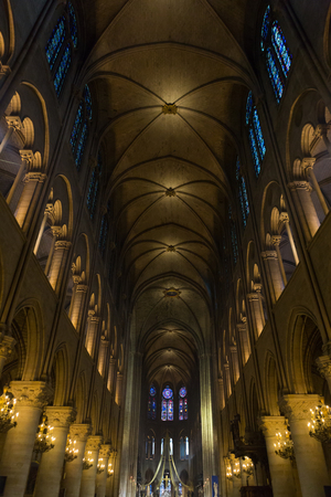 nave: Lit up nave of Notre Dame cathedral in Paris, France