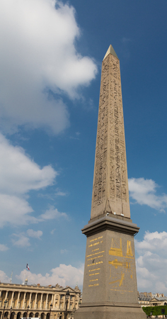 champs elysees: Obelisk on the Avenue de Champs Elysees in Paris, France on a sunny day. Stock Photo