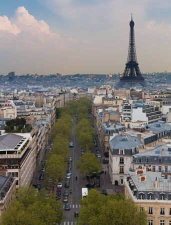 The Eiffel Tower and skyline of Paris, France shot from the Arc de Triomphe.