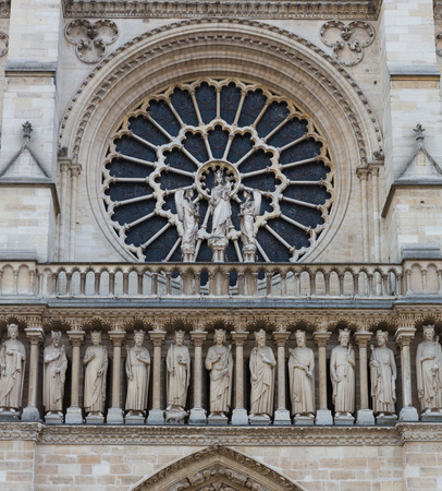Rose window and freize of Notre Dame in Paris, France. photo