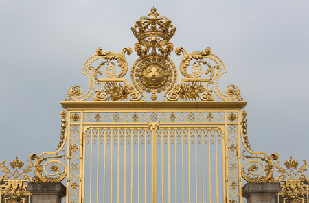 Gold gate at the palace of Versailles in Paris, France. Stock Photo - 28257610