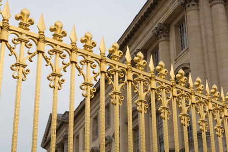 Gold gate at the palace of Versailles in Paris, France. Stock Photo
