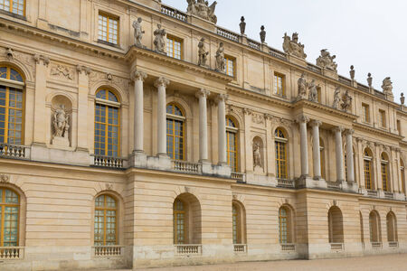Exterior of the palace of Versailles in Paris, France on a sunny day.