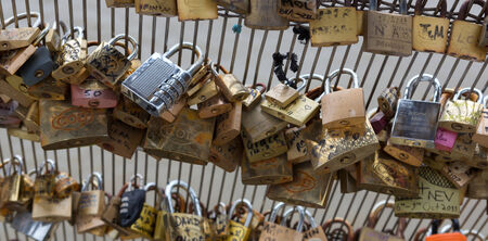 Locks on the bridge of love across the Seine in Paris, France.