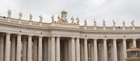 Colonnade outside St. Peters Basilica in Vatican City, Italy on an overcast day.