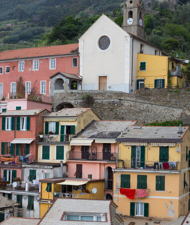 Colorful buildings and church of Vernazza in Cinque Terre, Italy. Stock Photo - 28258020