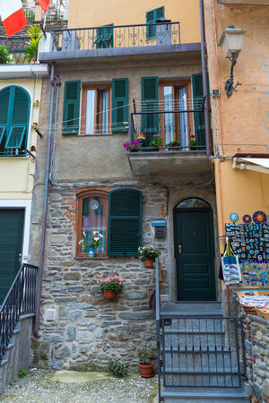 Colorful Italian house with shutters in Vernazza in Cinque Terre, Italy.