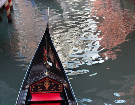 Beautiful gondola showing details parked along a quiet Venice, Italy canal photo
