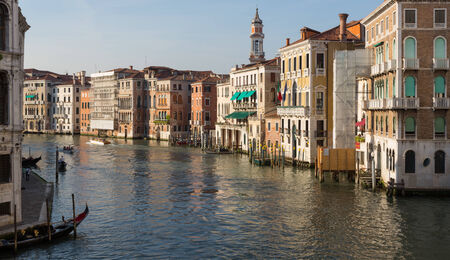 Grand Canal and buildings bathed in sunlight at sunset in Venice, Italy Stock Photo