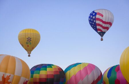 Two Hot Air Balloons above the Rest