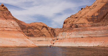 large formation: Large desert rock sandstone formation in the sunshine at Lake Powell, Utah Stock Photo