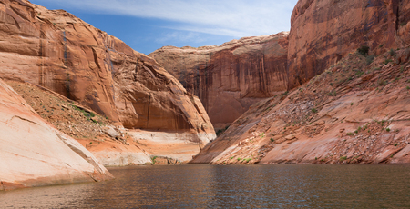 rock formation: Large desert rock sandstone formation in the sunshine at Lake Powell, Utah Stock Photo