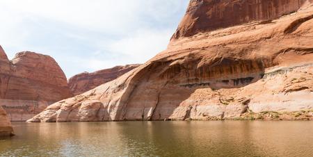 lake powell: Large desert rock sandstone formation in the sunshine at Lake Powell, Utah Stock Photo