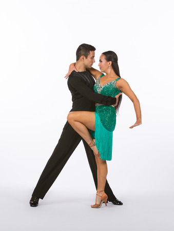 Two young ballroom dancers in studio taken against a high-key white background Stock Photo - 86132822