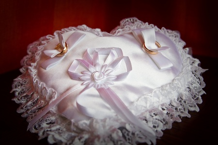 Wedding rings on a small pillow Stock Photo - 8679676