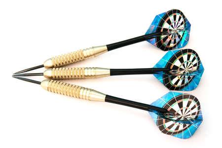 Set of aligned three darts isolated over white background photo