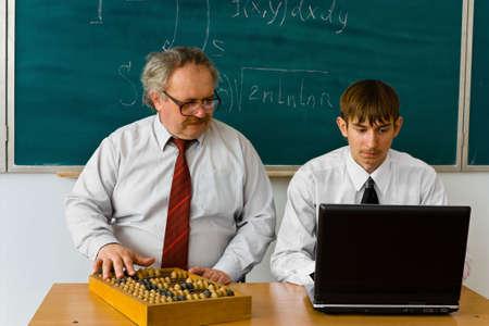 Facetious composition abacus vs laptop