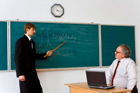 A young man takes the exam in mathematics Stock Photo - 5103583