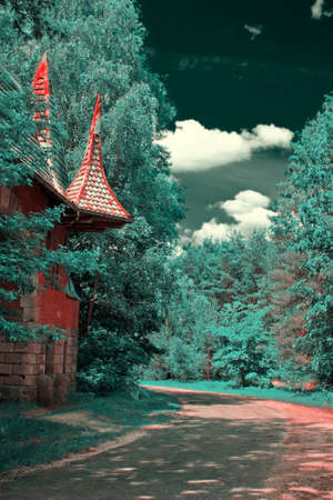 dichromatic: Forest landscape with a road and old arch. Tinted into dichromatic