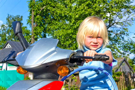 Portrait of a little girl on scooter Stock Photo - 5143786