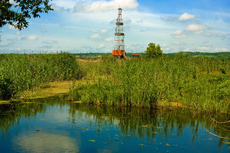 Drill derrick in the natural landscape Stock Photo