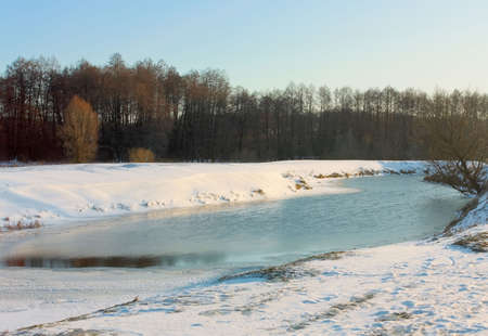 Winter river in countryside landscape photo