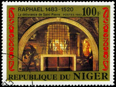 d�livrance: NIGER - vers 1983: Un timbre montre Raphael peinture � D�livrance de Saint Pierre �, vers 1983 Banque d'images