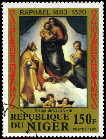NIGER - CIRCA 1983: A Stamp shows Raphaels painting Sistine Madonna, circa 1983 photo