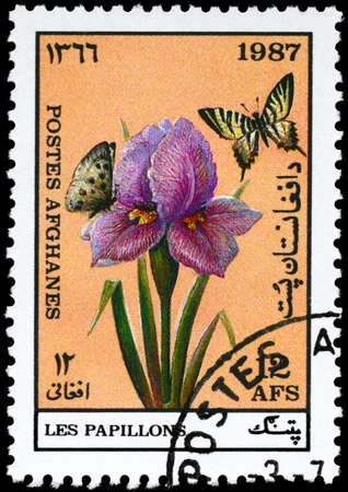 afghanistan: AFGHANISTAN - CIRCA 1987: A Stamp printed in AFGHANISTAN shows image of a Butterflies by Flower, series, circa 1987
