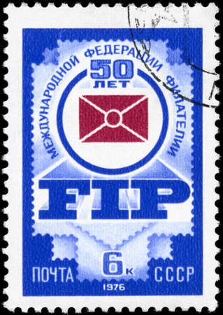 philately: USSR - CIRCA 1976: A Stamp printed in USSR shows the Emblem of a Intl.Federation of Philately, 50th Anniv., circa 1976 Stock Photo