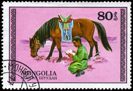 mongolia horse: MONGOLIA - CIRCA 1977: A Stamp printed in MONGOLIA shows the image of the Grazing Horse & Student, series, circa 1977 Stock Photo