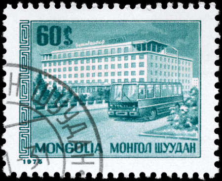 MONGOLIA - CIRCA 1975: A Stamp printed in MONGOLIA shows the Hotel Ulan Bator, series, circa 1975 photo