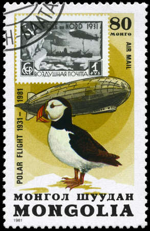 graf: MONGOLIA - CIRCA 1981: A Stamp printed in MONGOLIA shows the image of the Graf Zeppelin & Puffin from the series Polar Flight 1931-1981, circa 1981 Stock Photo