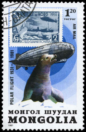 graf: MONGOLIA - CIRCA 1981: A Stamp printed in MONGOLIA shows the image of the Graf Zeppelin & Seal from the series Polar Flight 1931-1981, circa 1981 Stock Photo