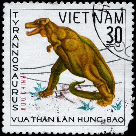 VIETNAM - CIRCA 1978: A Stamp printed in VIETNAM shows image of a Tyrannosaurus from the series Dinosaurs, circa 1978 photo