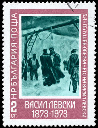 BULGARIA - CIRCA 1973: A Stamp printed in BULGARIA shows the Painting Execution of Levski of the artist Boris Angelushev and devoted to Centenary of the death of Vassil Levski (1837-1873), patriot, executed by the Turks, circa 1973 photo