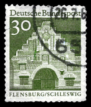 GERMANY - CIRCA 1965: A Stamp printed in GERMANY shows the Nordertor, Flensburg, from the series Designs, circa 1965 photo
