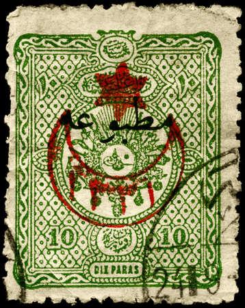 TURKEY - CIRCA 1890: A Stamp printed in TURKEY shows the Arms and Tughra of �El Gazi�(The Conqueror) Sultan Abdul Hamid, series, circa 1890 photo