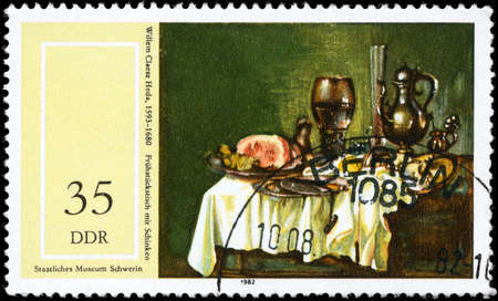GDR - CIRCA 1982: A Stamp printed in GDR shows Breakfast Table with Ham,  by Willem Clacsz Heda (1593-1680), from the series 17th Cent. Paintings in Natl.  Museum, Schwerin, circa 1982 photo