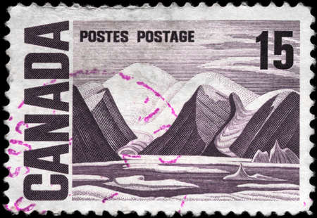 CANADA - CIRCA 1967: A Stamp printed in CANADA shows the painting  �Bylot Island� by Lawren Harris, series, circa 1967 photo