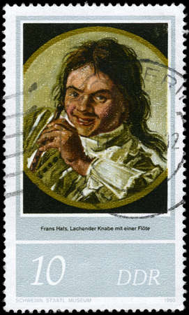 frans: GDR - CIRCA 1980: A Stamp printed in GDR shows the painting Laughing Boy with Flute by Frans Hals (1580-1666), series, circa 1980