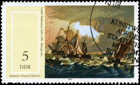 GDR - CIRCA 1982: A Stamp printed in GDR shows the painting Seascape, by Ludolf Backhuysen (1631-1708), from the series 17th Cent. Paintings in Natl. Museum, Schwerin, circa 1982 photo