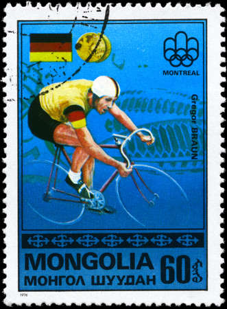 MONGOLIA - CIRCA 1976: A Stamp printed in MONGOLIA shows the Gregor Braun, Montreal Games� Emblem, German Flag, Gold Medals from the series Gold medal winners, 21st Olympic Games, Montreal, Canada, circa 1976