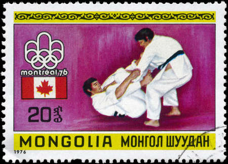 MONGOLIA - CIRCA 1976: A Stamp printed in MONGOLIA shows the Judo, Montreal Games� Emblem, Canadian Flag, from the series 21st Olympic Games, Montreal, Canada, circa 1976