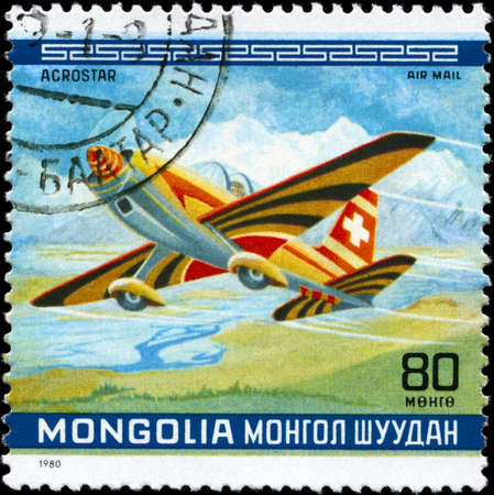 MONGOLIA - CIRCA 1980: A Stamp printed in MONGOLIA shows the Acrostar Plane, Switzerland, from the series 10th World Aerobatic Championship, circa 1980 photo
