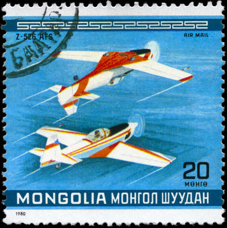 MONGOLIA - CIRCA 1980: A Stamp printed in MONGOLIA shows the Z-526 AFS Stunt Planes, Czechoslovakia, from the series 10th World Aerobatic Championship, circa 1980 Stock Photo