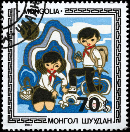 MONGOLIA - CIRCA 1983: A Stamp printed in MONGOLIA shows the Boy and Girl, from the series Children in Various Activities, circa 1983 photo